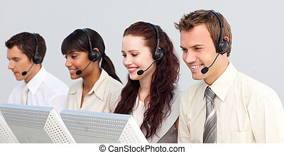 Business team working in a call center - Business team with...