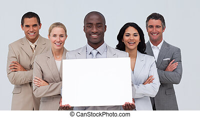 Afro-American businessman holding a white card with his team...