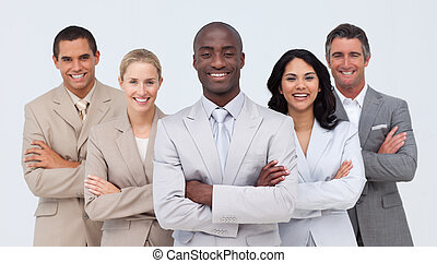 Smiling African businessman leading his team against white...
