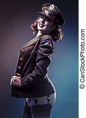 Retro, pinup girl in sexy clothes era of World War II