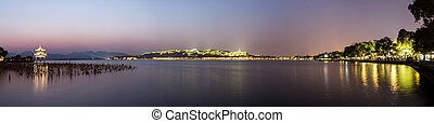 panoramic waterscape of west lake during sunset - sunset...