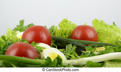 Onions, boiled eggs, lettuce, tomatoes, parsley - Close-up...