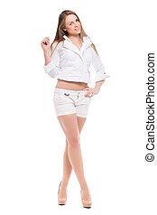 Beautiful blond woman wearing white shirt and shorts...