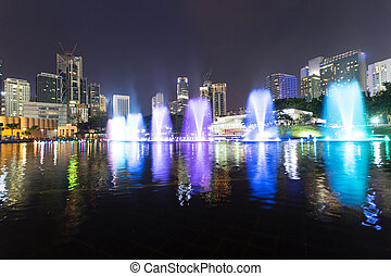 music fountain in the square of KLCC at night,kuala lumpur -...