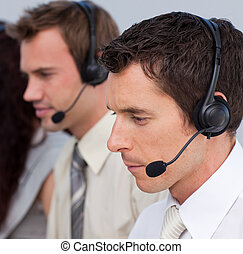 Portrait of an attractive man working in a call center