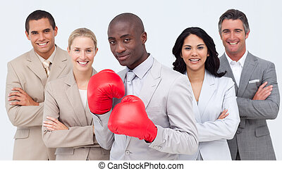 Afro-American businessman with boxing gloves leading his...