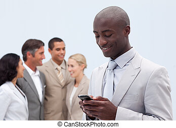 Attractive Afro-American businessman writing a message