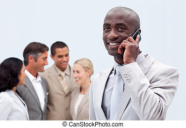 Afro-American businessman talking on mobile phone