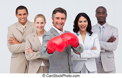Businessman with boxing gloves leading his team - Attractive...