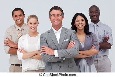 Smiling business team standing against white background -...
