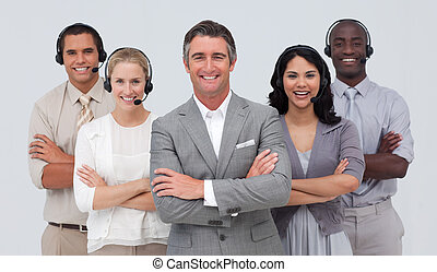 Multi-ethnic team working in a call center - Smiling...