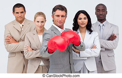Confident businessman boxing and leading his team