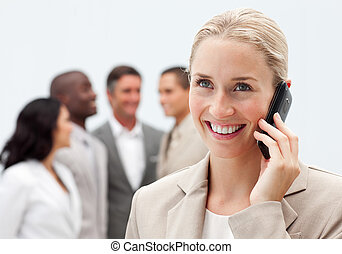 Beautiful businesswoman on phone in workplace