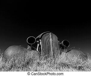 capture IR of rusty vintage car in a ghost town - photo...