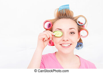 Young girl with curlers on her hair - Happy youth Young...