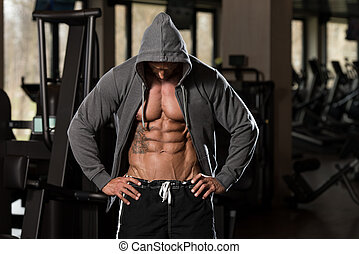 Portrait Of A Physically Fit Man In Hoodie - In Modern...