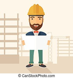 Construction worker holding the plan - A young hipster...