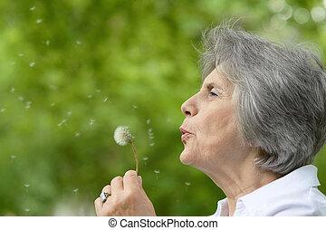 elderly woman on a walk - Portrait of an elderly woman on a...