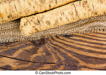 Horseradish - Photo of horseradish root on burlap and wooden...