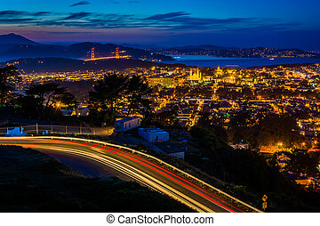Twin Peaks Boulevard and view of San Francisco at night, from Twin Peaks, in San Francisco, California.