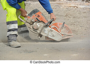 Concrete Saw - Construction worker operated Circular saw...
