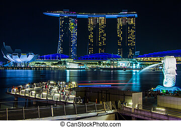 SINGAPORE- February 8, 2015: SINGAPORE-JAN 31, 2015: The Merlion fountain in front of the Marina Bay Sands hotel and view of Marina Bay in Singapore