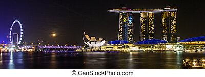 SINGAPORE- February 8, 2015: The Merlion fountain in front of the Marina Bay Sands hotel and view of Marina Bay in Singapore