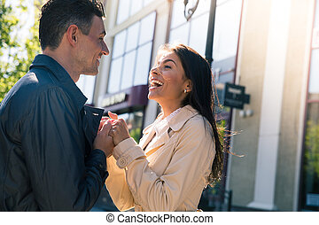 Happy young couple flirting outdoors - Portrait of a happy...