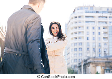 Happy woman flirting with man outdoors - Happy beautiful...