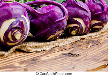Kohlrabi - Photo of kohlrabi heads on burlap and wooden...