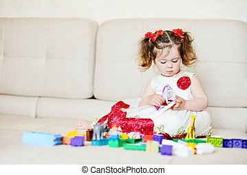 toddler playing with blocks - toddler girl playing with...