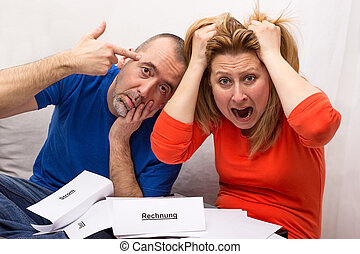 Personal insolvency - A man and a woman in despair because...