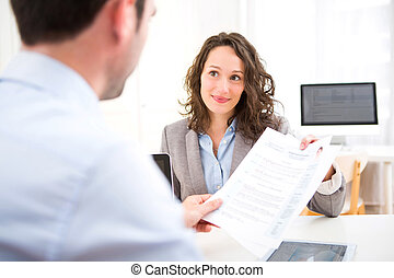 Young attractive woman during job interview - View of a...