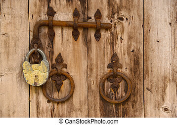 old wooden door - Rusty vintage padlock on an old wooden...