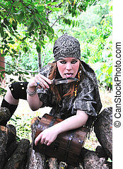 pirate girl is licking knife - beautiful redheaded pirate...