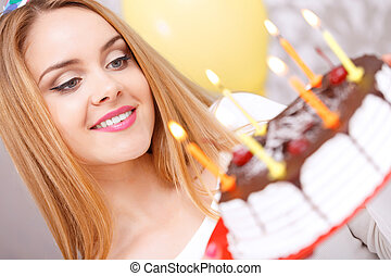 Happy girl and her birthday cake