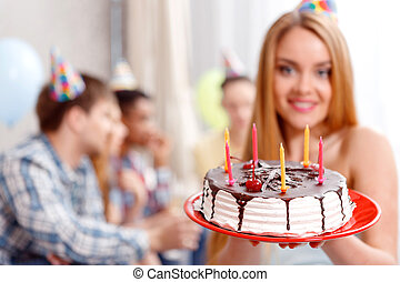 Young girl with her birthday cake