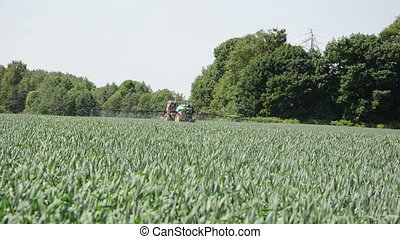 farm tractor field corn - farm tractor with long spray...