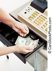 Cash Register - Small Change - Closeup of a cashier\'s hands...