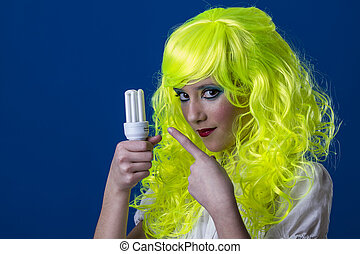 Environment, concept electricity, young girl with a light bulb in hand