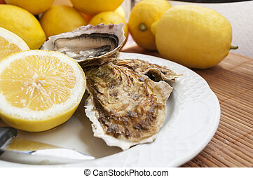 oysters - appetizing French oysters with lemon, delicious,...