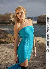 Model on the stony beach