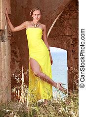 Model in yellow dress posing outdoor