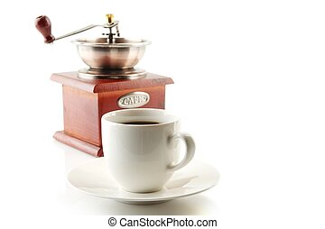 Cup of coffee with saucer and mill on white - Coffee cup and...