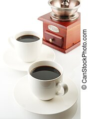 Cups of coffee with saucer and mill on white - Coffee cups...
