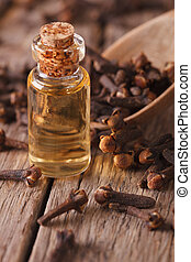 clove oil in a bottle of glass macro vertical - clove oil in...