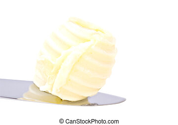 Butter curl - Single perfect butter curl on a knife with...