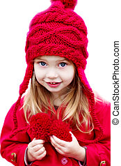 Child in Winter Hat - Happy little girl dressed for winter