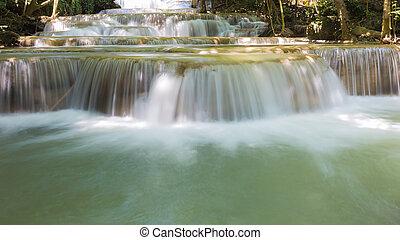 Blue stream water falls locate in deep forest jungle,...