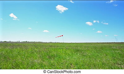 Windsock against sky. - Windsock against cloudy sky....